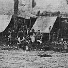 Soldiers in a camp writing letters